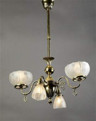 Four light gasolier style gilt brass chandelier