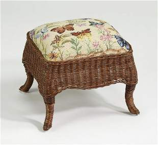 Wicker and needlepoint footstool