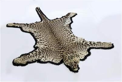 Vintage African leopard hide rug, ca 1910