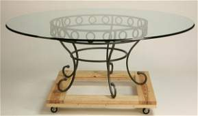 132 Glass top table with wrought iron base