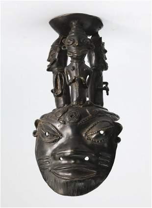 Bronze figural Gelede style spirit mask
