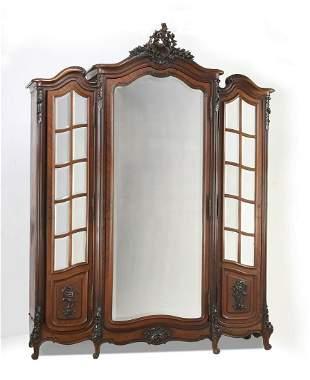 19th c. Louis XV style walnut triple door armoire