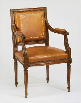Regency style walnut and leather armchair