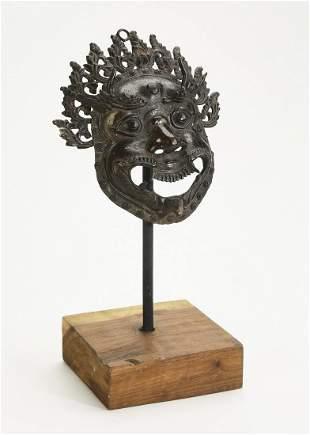 Nepalese metal mask of Mahakala w/ stand
