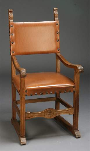 19th c. carved walnut armchair in leather
