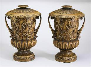 Pair of relief carved lidded urns