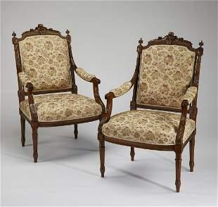 (2) French Louis XVI style walnut fauteuils, 19th c.
