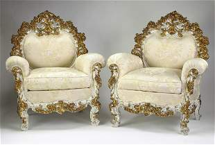 (2) Italian Rococo style carved and gilt bergeres