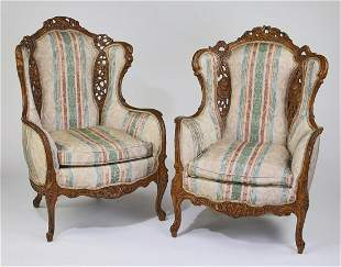 (2) Victorian style carved walnut wing chairs