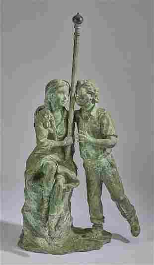 Bronze garden sculpture of two bucolic children