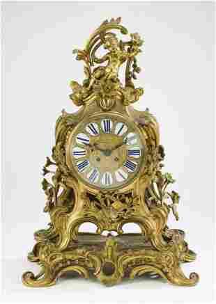 19th c. French Rococo style gilt bronze mantel clock