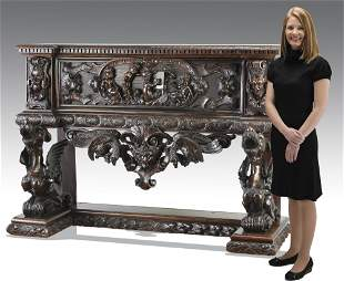 Heavily carved 19th c. Italian buffet w/ gryphons