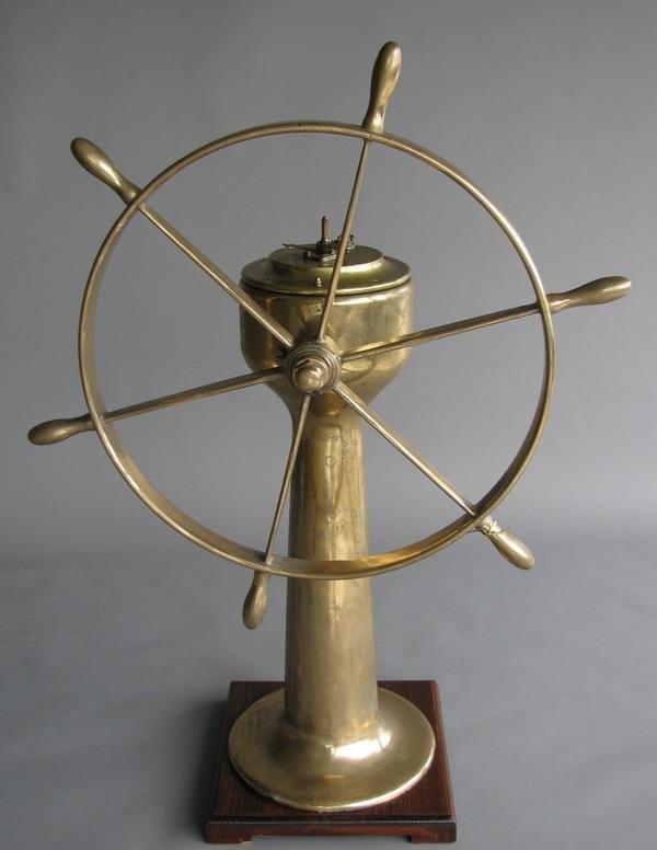 23: 19th c. bronze ship's wheel