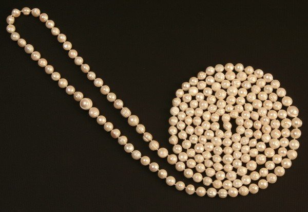 17: Single strand of 12mm freshwater pearls, 118""
