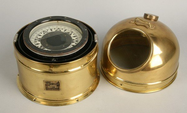 7: Ship's magnetic compass in brass case
