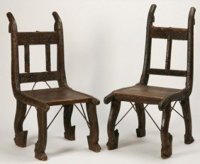 9: (2) chairs crafted from antique Afghan carts