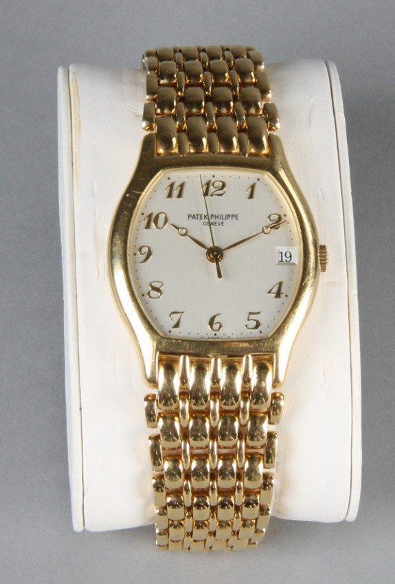 20: Men's Patek Philippe 18kt gold watch