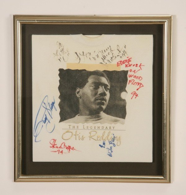 8: Framed and autographed T-shirt