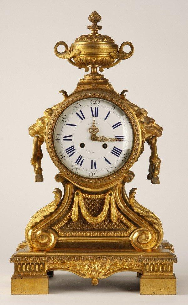 8: 19th c. French dore' bronze clock