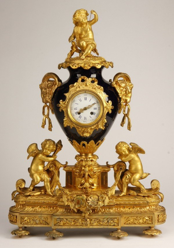 16: 19th c. French bronze and porcelain clock