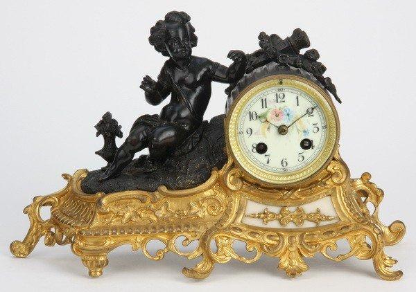 23: 19th c. bronze figural clock