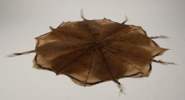 57: Round deer skin rug