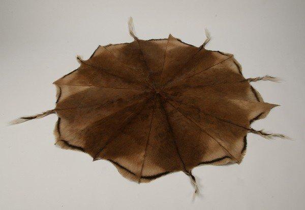 57: Round deer skin rug - 2