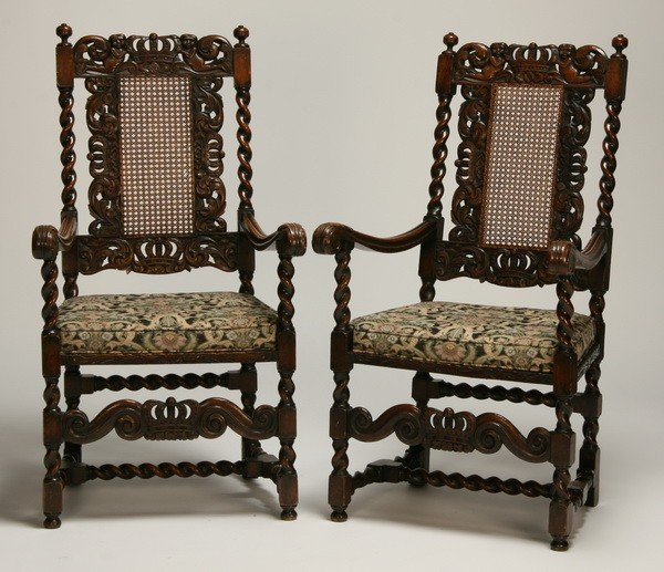 21: (2) 19th c. carved English oak arm chairs