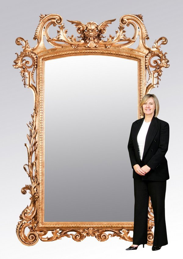 "30: Monumental carved gilt wood mirror, 105""h"
