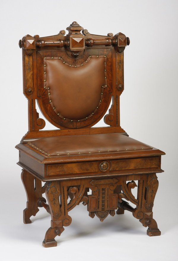 13: 19th c. carved walnut chair in leather