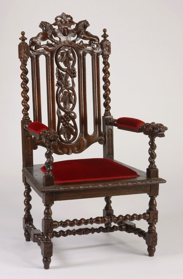 23: 19th c. French carved oak armchair