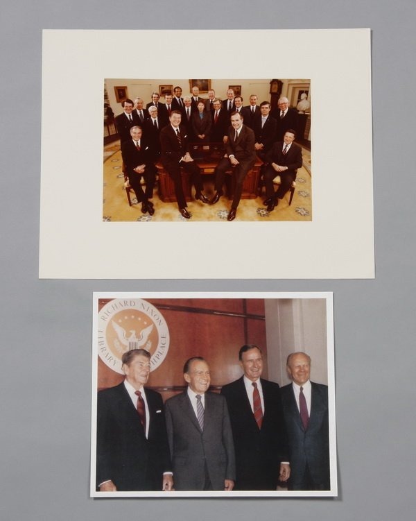 22: Two Presidential photographs