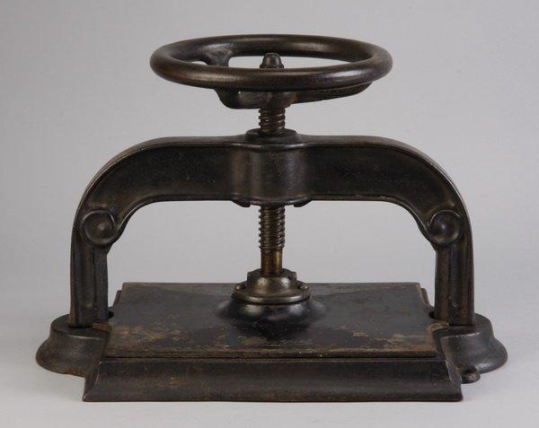 16: 19th c. American cast iron book press