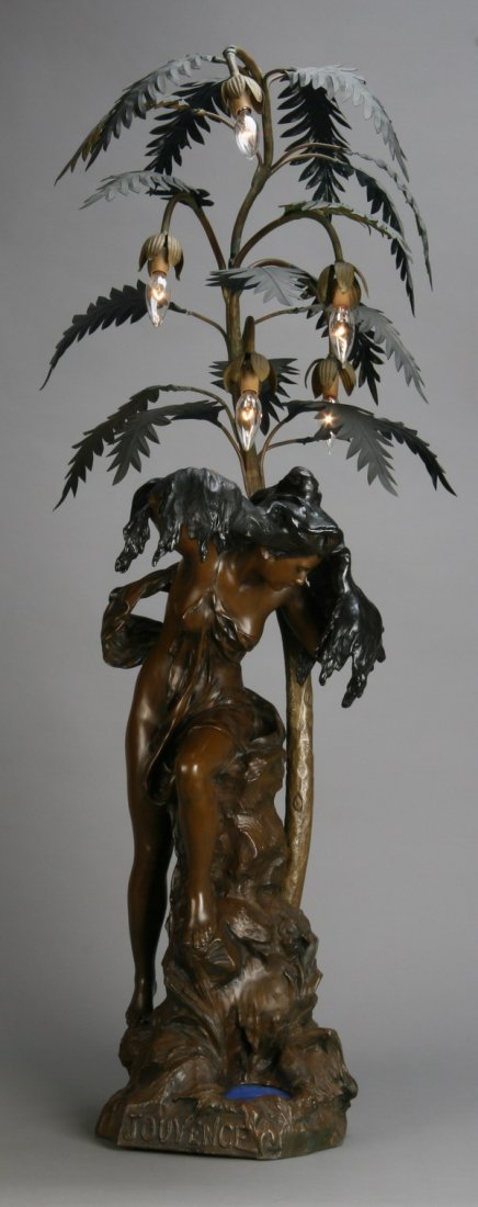 21: Early 20th c. figural newell post lamp