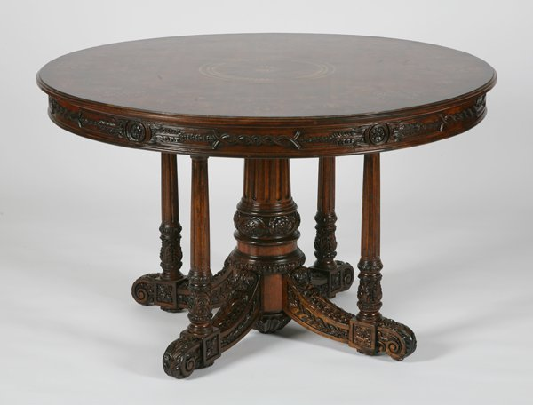 21: Marquetry inlaid carved mahogany center table