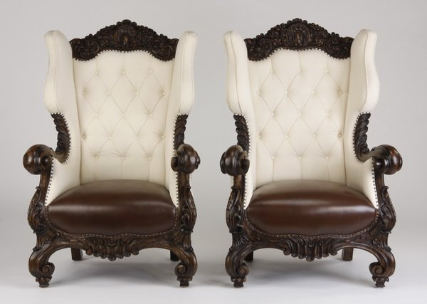 2 oversized carved mahogany wingback chairs