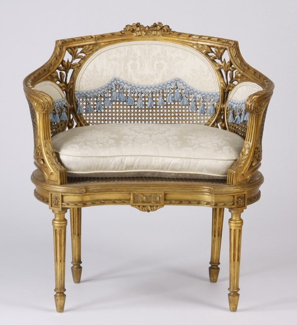 Louis XVI style gilt wood and cane bergere