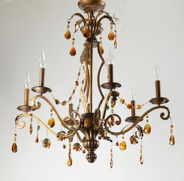 Patinated chandelier with glass prisms