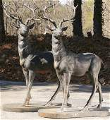 Pair of patinated bronze stags 60h