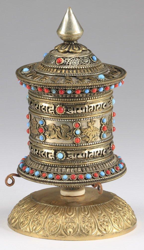 Tibetan Buddhist hand-held prayer wheel
