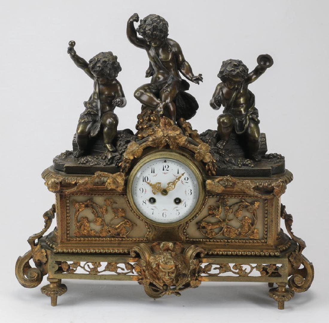 Bronze and marble mantel clock with putti