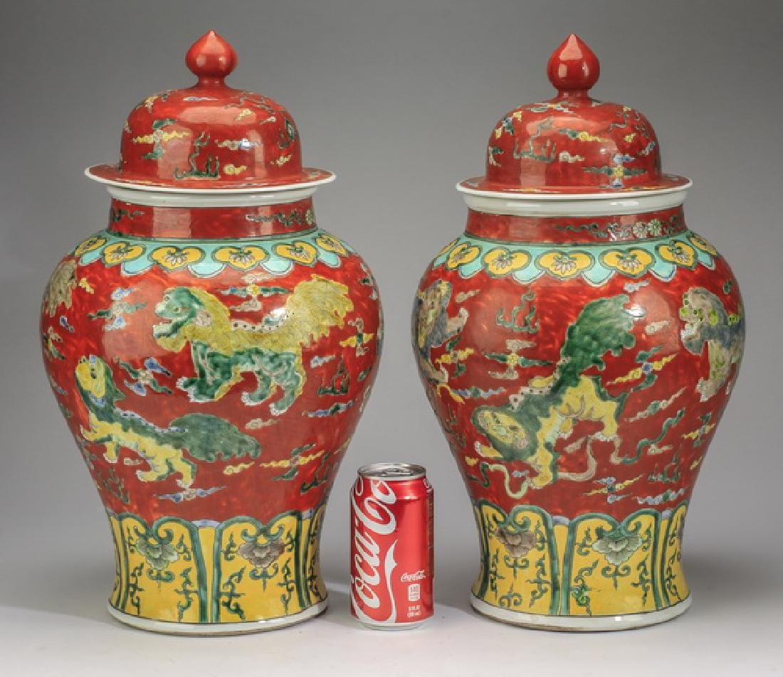 "(2) Chinese red ground, Fu lion jars, 20""h"