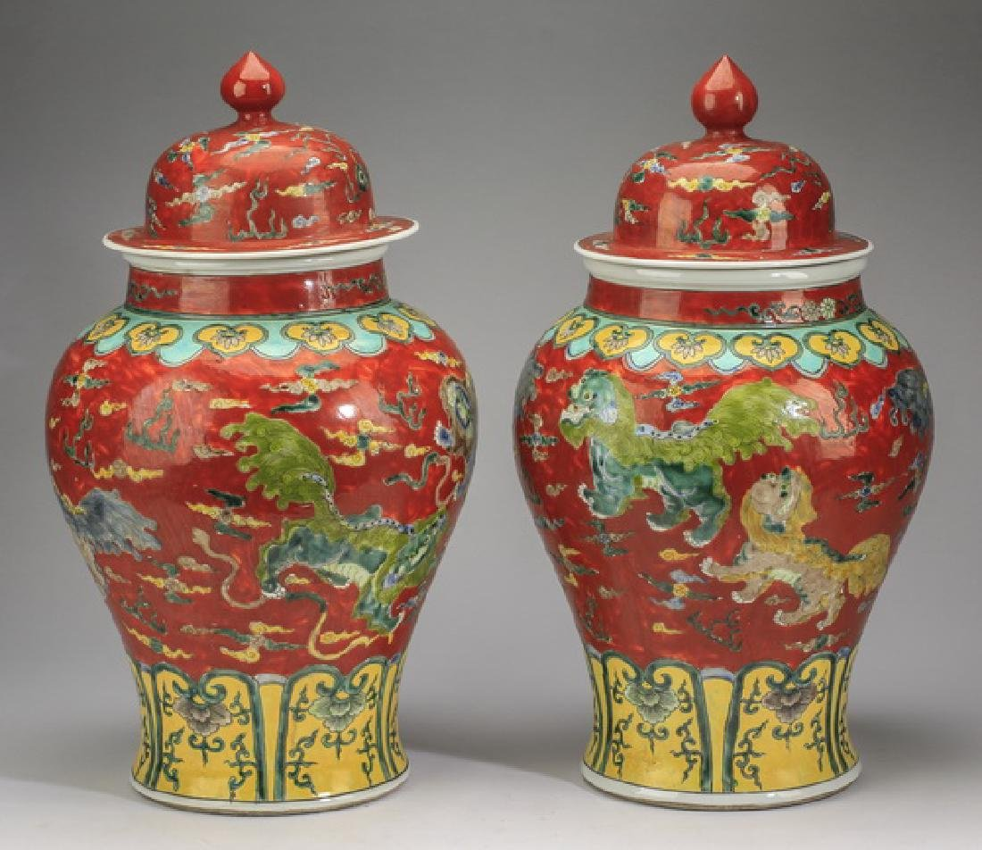 "(2) Chinese red ground, Fu lion jars, 20""h - 2"