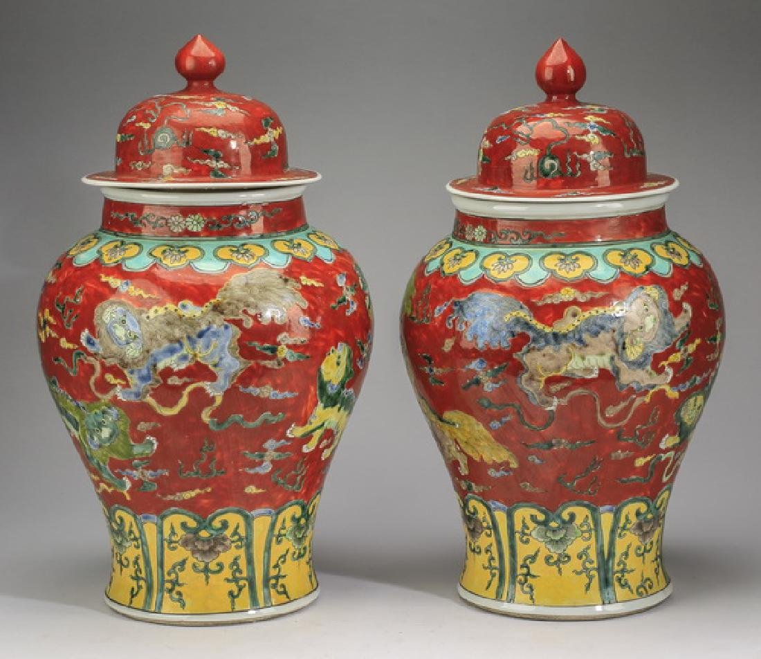 "(2) Chinese red ground, Fu lion jars, 20""h - 3"