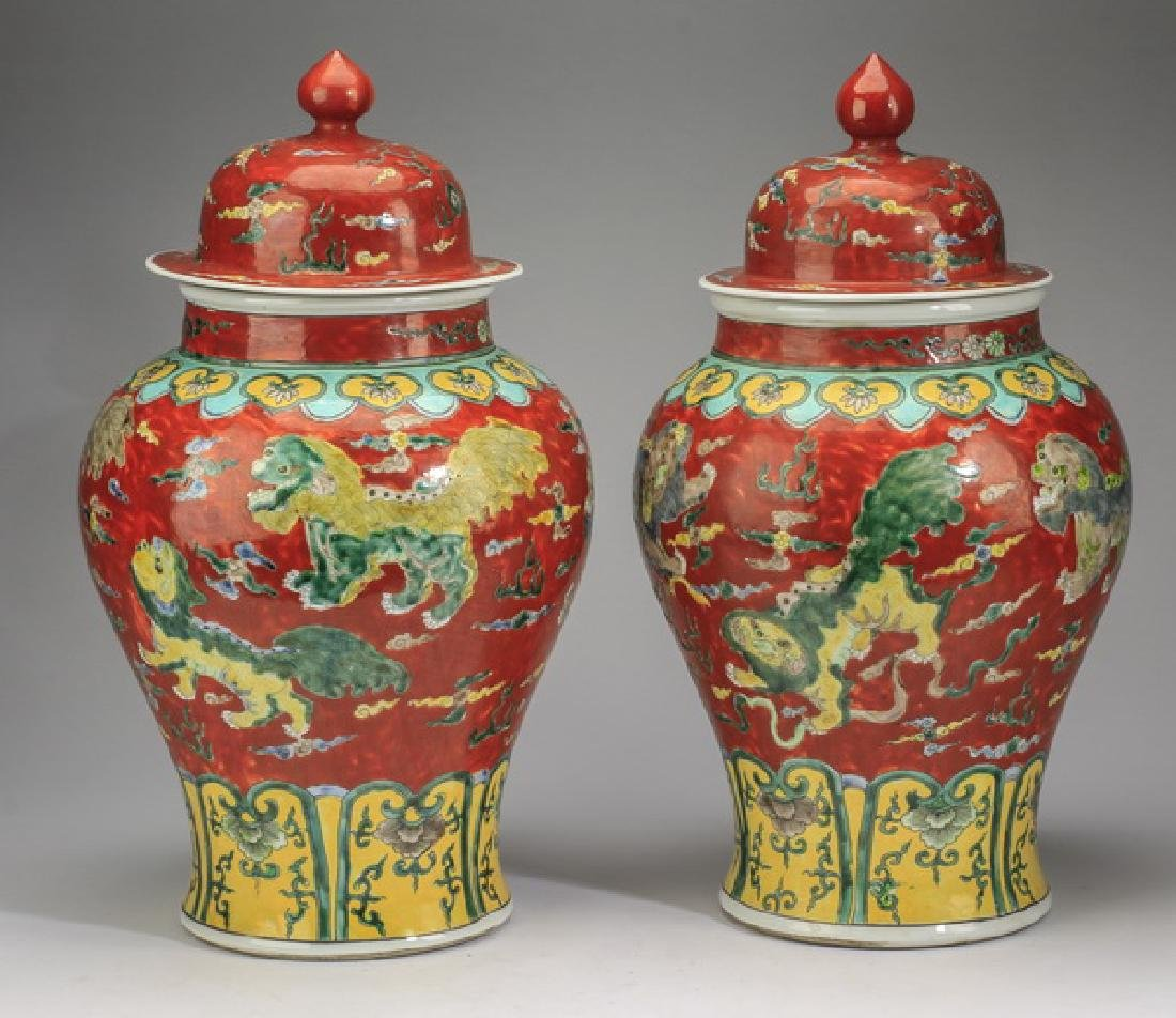 "(2) Chinese red ground, Fu lion jars, 20""h - 4"