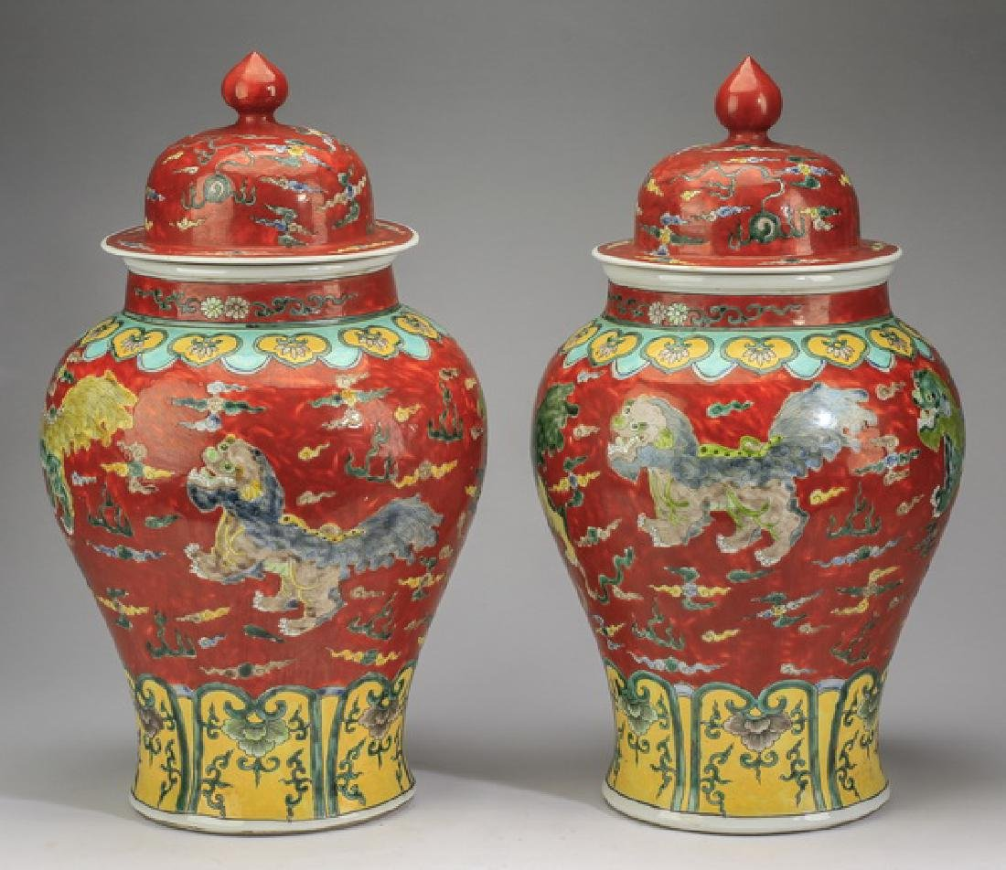 "(2) Chinese red ground, Fu lion jars, 20""h - 5"