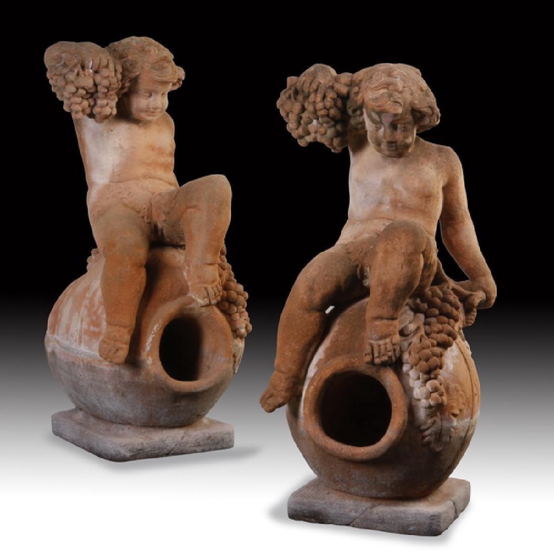 "(2) Italian cast stone putti sculptures, 36""h"