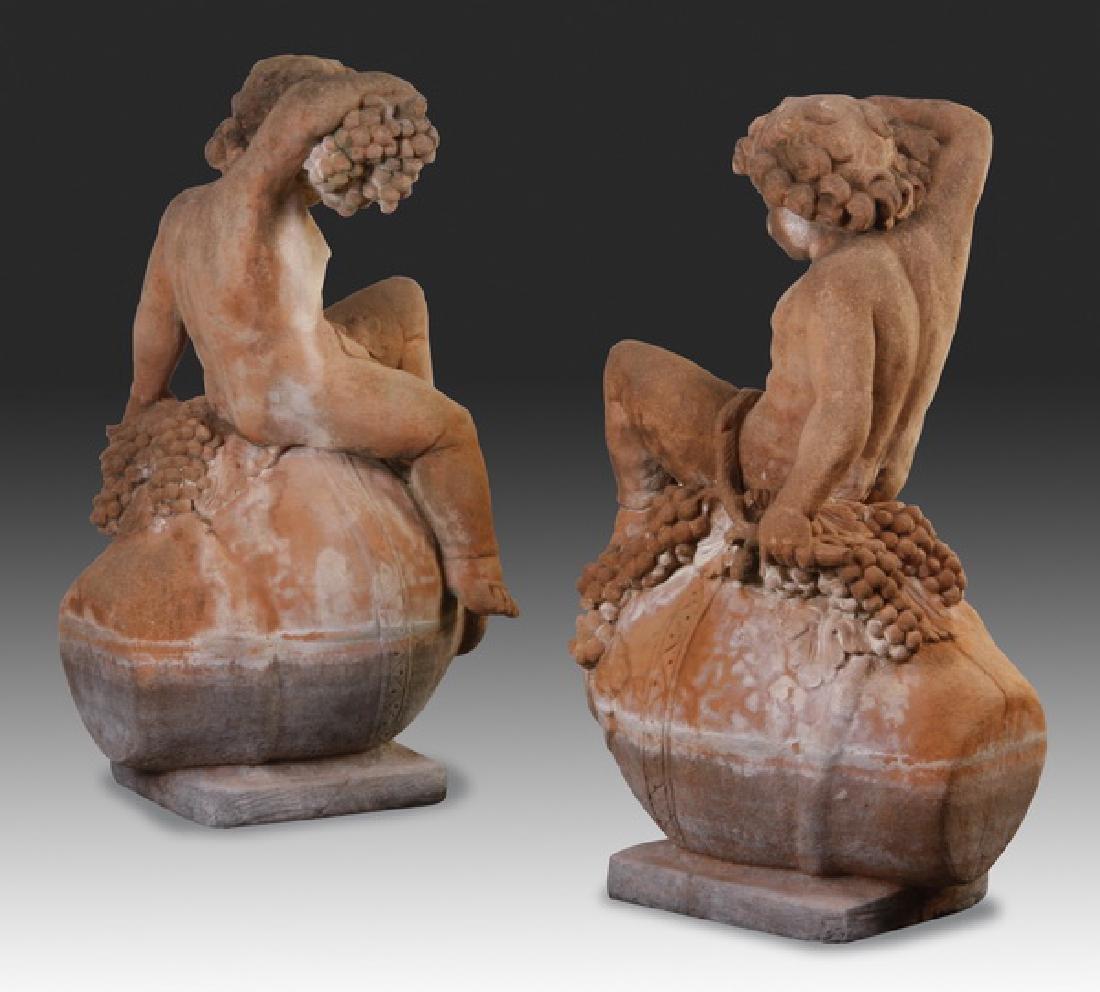 "(2) Italian cast stone putti sculptures, 36""h - 6"