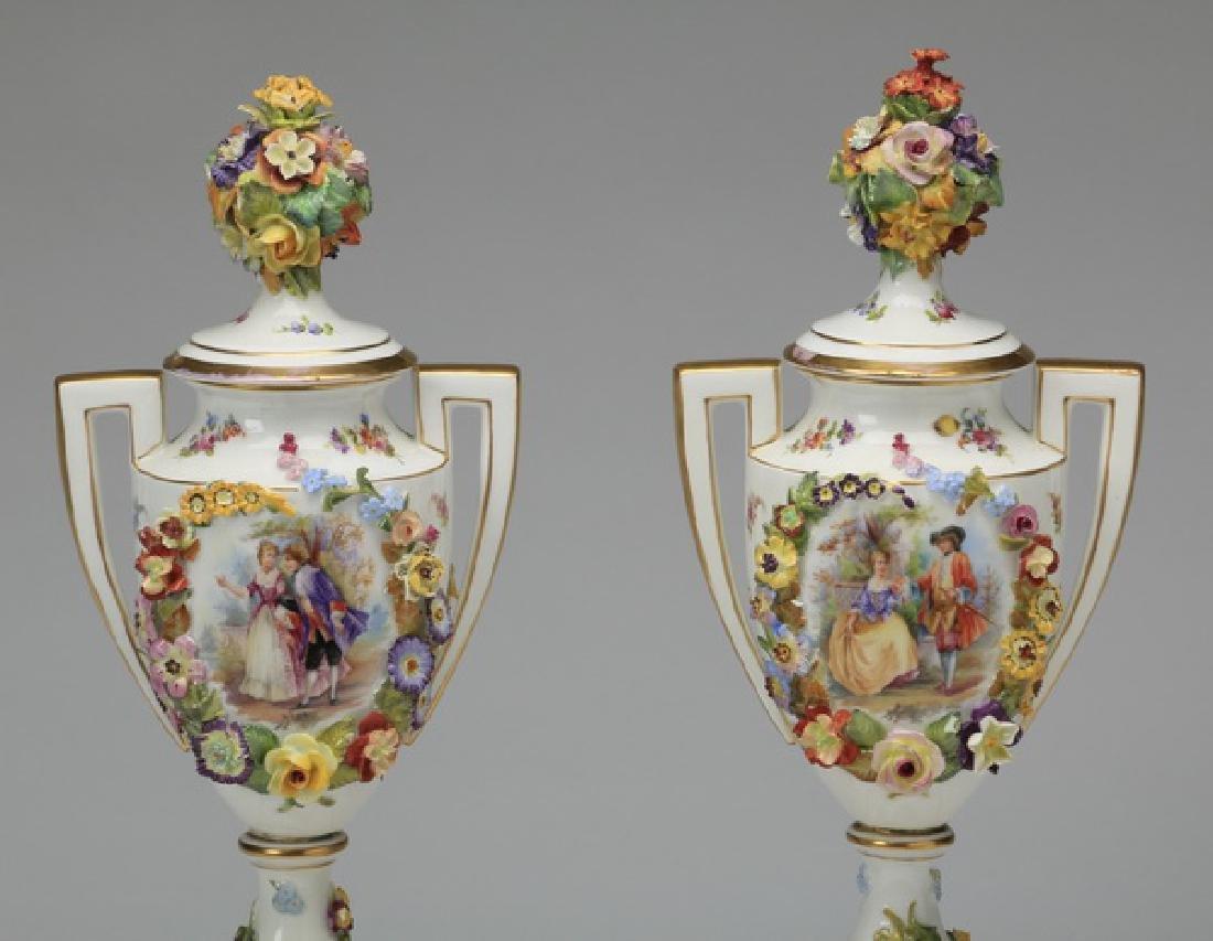 "(2) 19th c. Dresden lidded urns, marked, 19""h - 2"