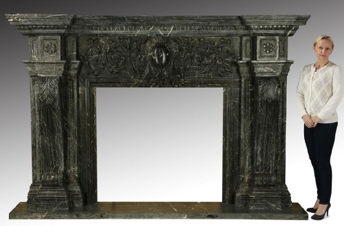 "Carved black marble fireplace mantel, 97""w."
